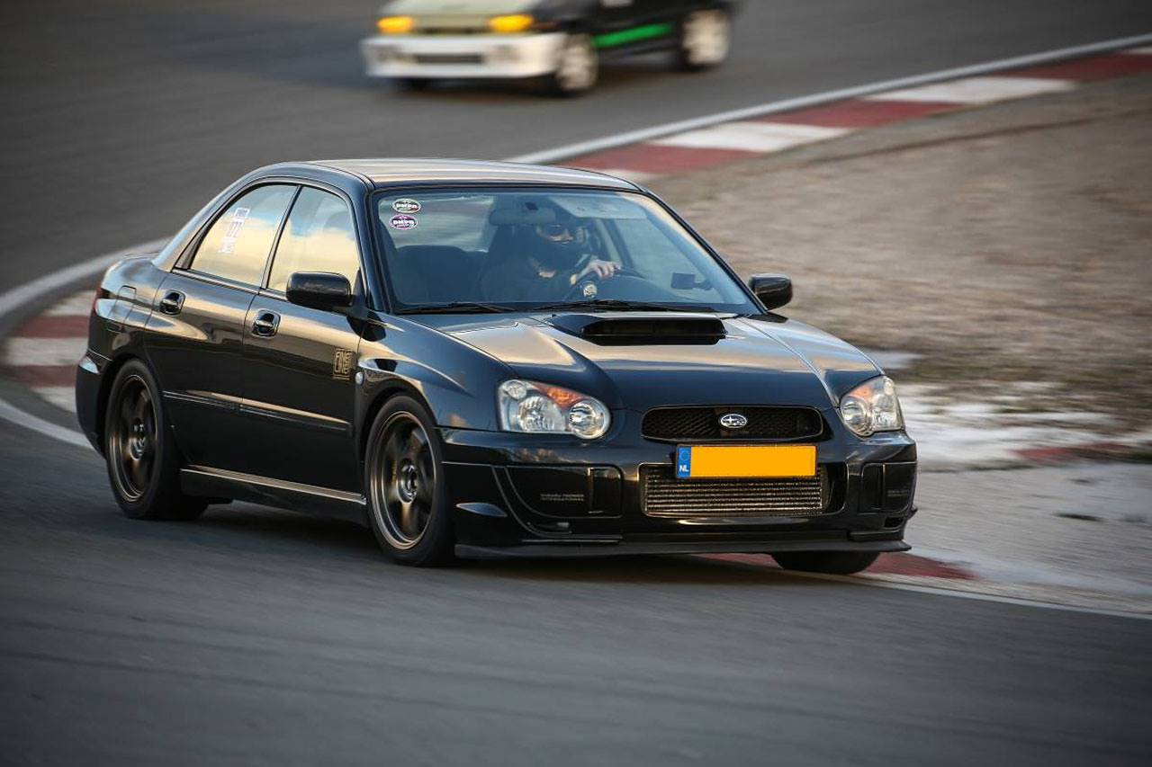 Yven's Subaru WRX my2004 fitted with full Supersprint exhaust, 961644 muffler with 100mm tips